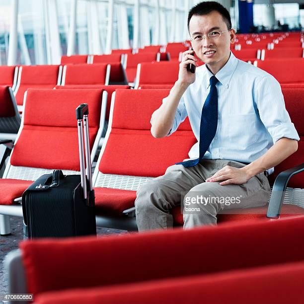 waiting traveller using mobile phone