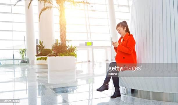 waiting traveller using smartphone
