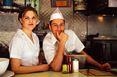 Waitress and cook in diner