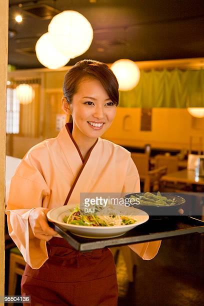 A Waitress Bringing Foods