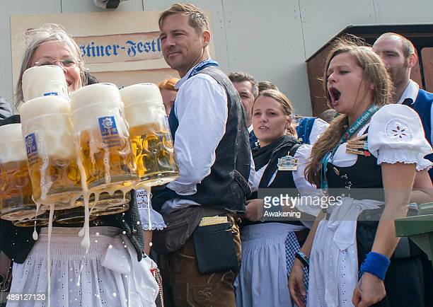 A waitress carries beer mugs on the opening of this year Oktoberfest on September 19 2015 in Munich Germany The 182nd Oktoberfest will be open to the...