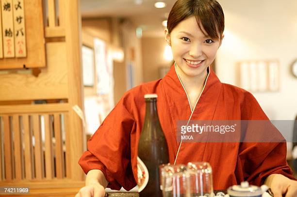 Waitress carrying a tray of beer