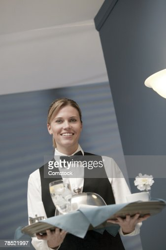 Waitress carrying food tray : Stock Photo