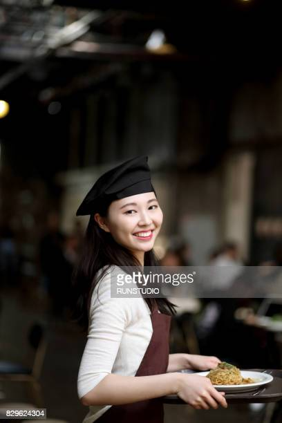 waitress carrying tray of food