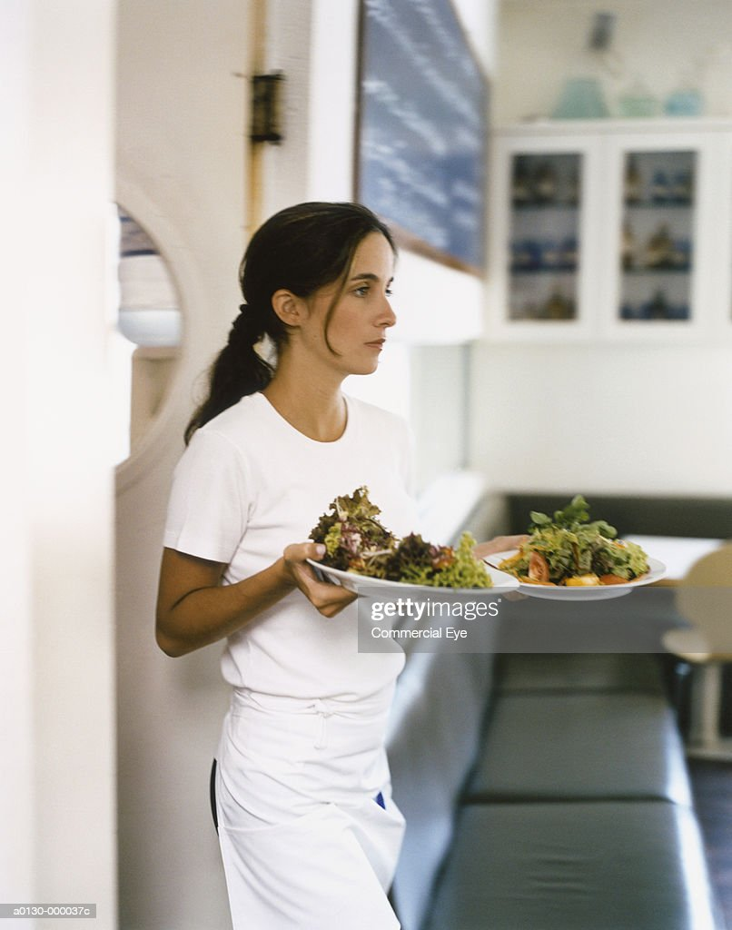 Waitress Carrying Two Plates : Stock Photo