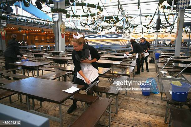 Waitress clean up tables at the Schottenhamel beer tent o the morning of to the opening day for the 2015 Oktoberfest on September 19 2015 in Munich...