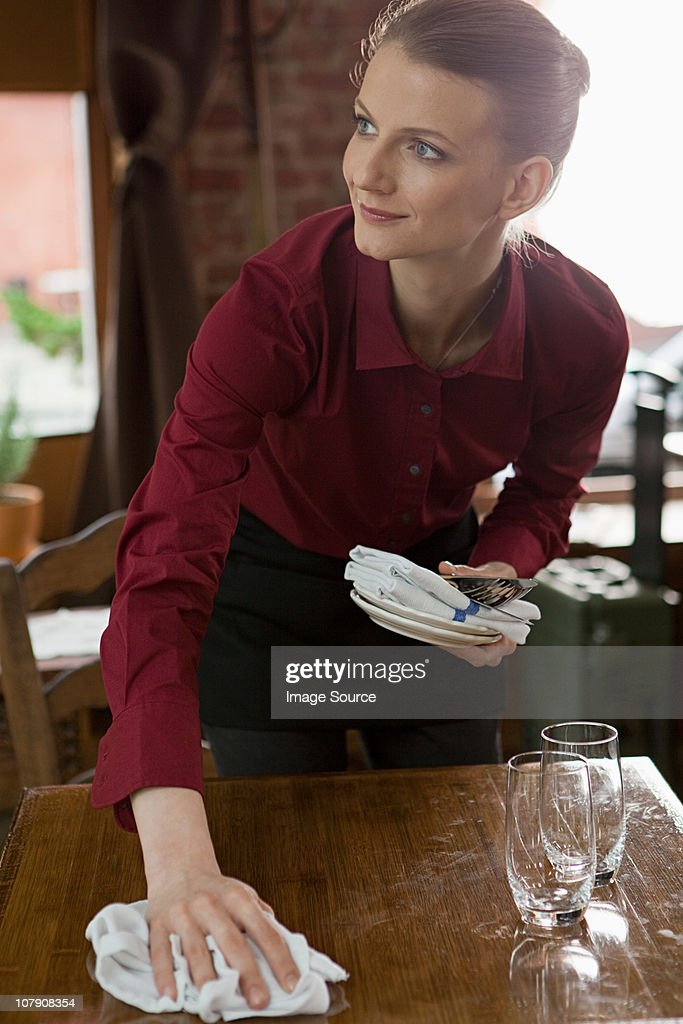 Waitress clearing table : Stock Photo