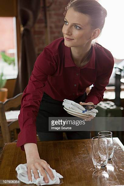 Waitress clearing table