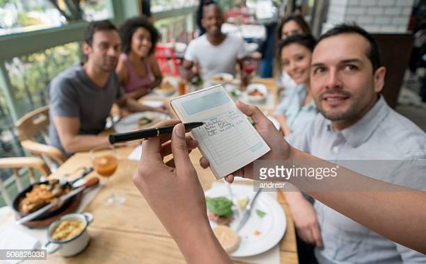 Waitress confirming an order at a restaurant