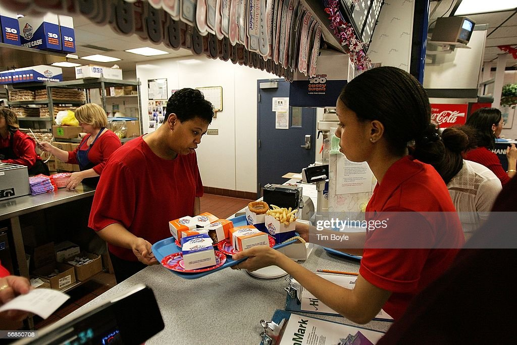 Waitress Danielle Wright (R) picks up a customer's order in a White Castle restaurant during a Valentine's Day dinner February 14, 2006 in Des Plaines, Illinois. For Valentine's Day, numerous White Castle restaurants nationwide took dinner reservations offering candlelit dining with individual servers as well as hostess seating.
