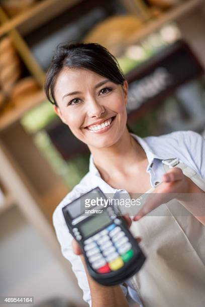 Waitress holding a credit card machine