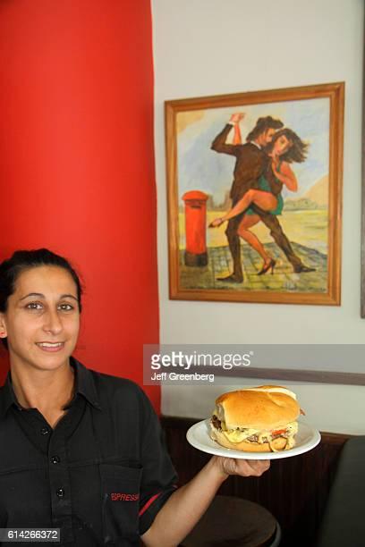 Waitress holding a sandwich in Cafe Espresso Resto Avenida Belgrano