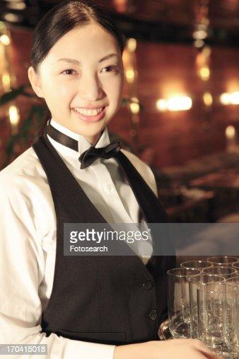 Waitress holding a tray : Stock Photo