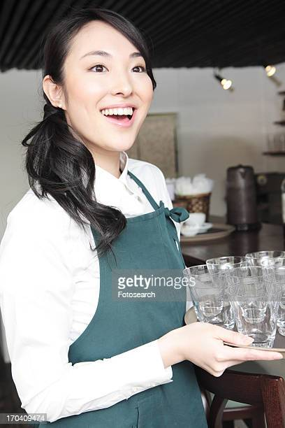 Waitress holding a try of glasses