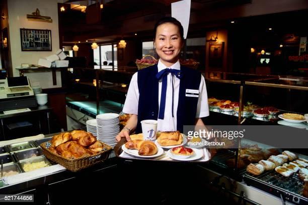 Waitress Holding Tray of Food