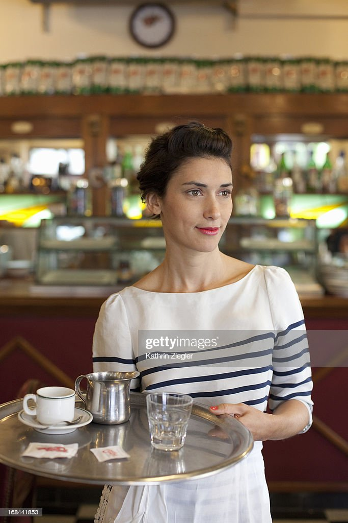 waitress in a beautiful café, holding tray