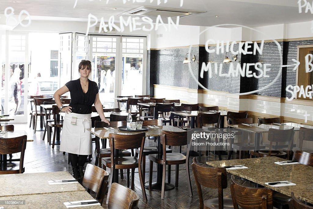 Waitress in a restaurant : Stock Photo