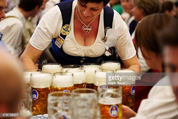Waitress in traditional Bavarian attire serving beer at the Oktoberfest on September 19 2010 in Munich Germany