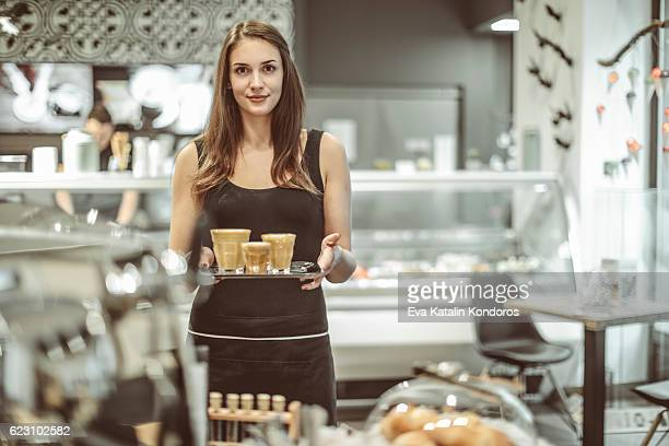 Waitress is serving a coffee