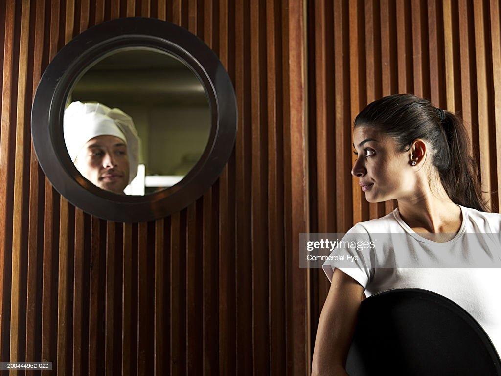 Waitress looking at chef in kitchen door window  Stock Photo  sc 1 st  Getty Images & Waitress Looking At Chef In Kitchen Door Window Stock Photo ... pezcame.com