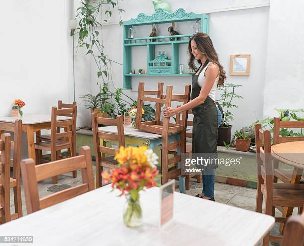 Waitress organizing tables at a restaurant