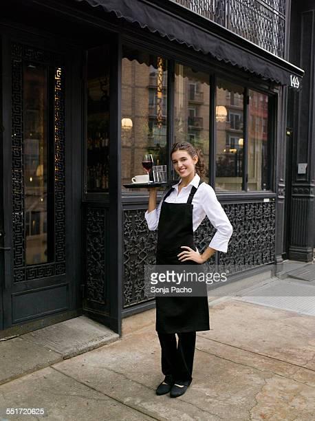 Waitress Posing in Front of Restaurant