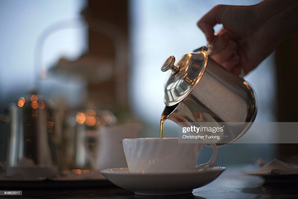 A waitress pours tea at Bettys Tea Room Harlow Carr on February 12 2009 in Harrogate England The family owned company Taylors of Harrogate have been...