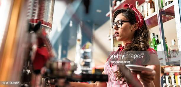 waitress preparing coffee at the bar counter
