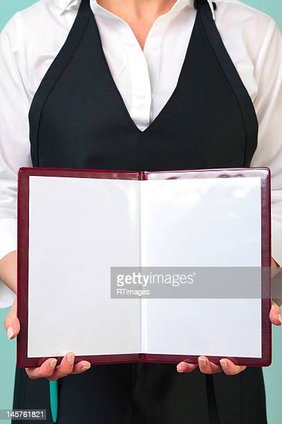 Waitress presenting a blank menu