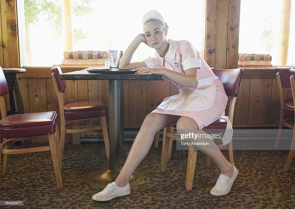 Waitress resting after work shift