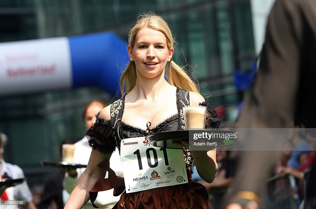 A waitress runs with a latte macchiato coffee drink during the Waiters' Derby (Kellner Derby in German) on August 4, 2013 in Berlin, Germany. At the annual event, brought back into existence in 2011 on the 125th anniversary of the Kurfuerstendamm (known locally as the Ku'damm), a main shopping thoroughfare, waiters, porters, cooks and bartenders run a 400-meter track while performing their regular occupational duties. The event was reinstated after a hiatus since the 1950s, when it was created to bring a sense of normal life back to Berlin after World War II under the Allies, a period in which gastronomical interest in the isolated Western part of the city suffered.