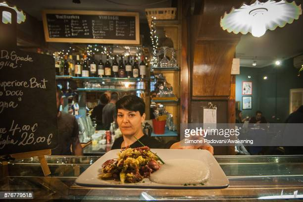 A waitress serves a 'Castradina' a dish made with dried mutton and cabbage typical of the traditional Festa della Salute on November 20 2017 in...