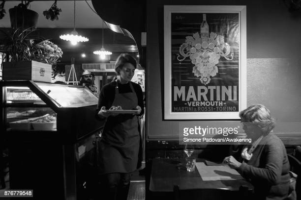 A waitress serves Castradina' a dish made with dried mutton and cabbage typical of the traditional Festa della Salute on November 20 2017 in Venice...