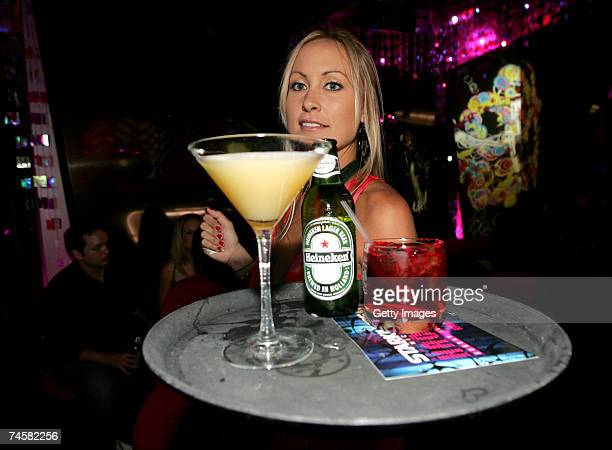 A waitress serves drinks featuring cocktails by Absolut vodka and Heineken beer at the CineVegas event at The Beatles Revolution Lounge at the Mirage...