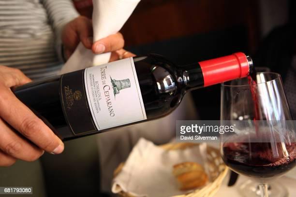 A waitress serves Fattoria Zerbina Torre di Ceparano Sangiovese di Romagna Superiore Riserva red wine at the Drogheria della Rosa restaurant on March...