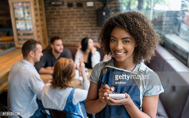 Waitress serving a group of friends at a restaurant