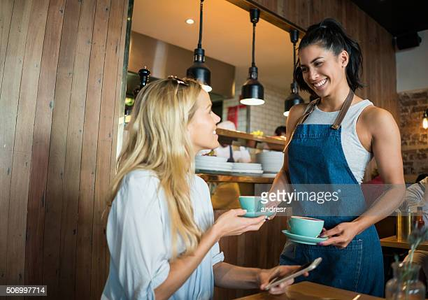 Waitress serving coffee to a customer