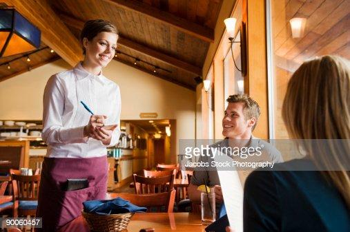 Waitress Serving Couple in Restaurant : Stock Photo
