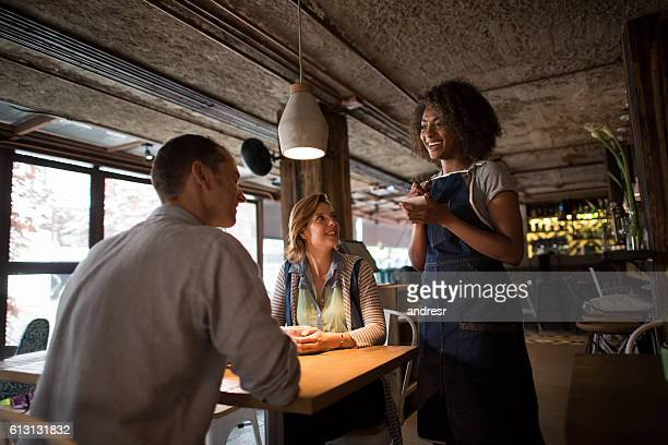 Waitress serving customers at a restaurant