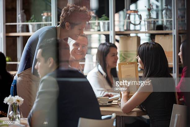 Waitress serving people at a restaurant