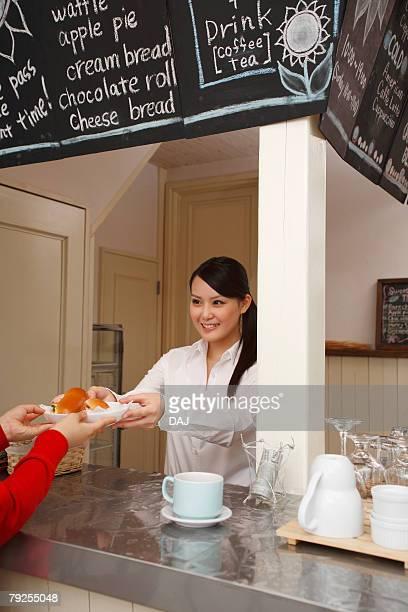 Waitress Serving Sandwiches