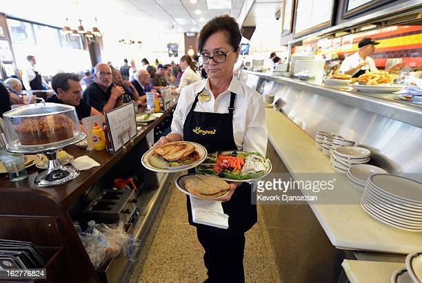 Waitress Sheila Abramson at Langer's Delicatessen serves customers on February 26 2013 in Los Angeles California According to a report America's...