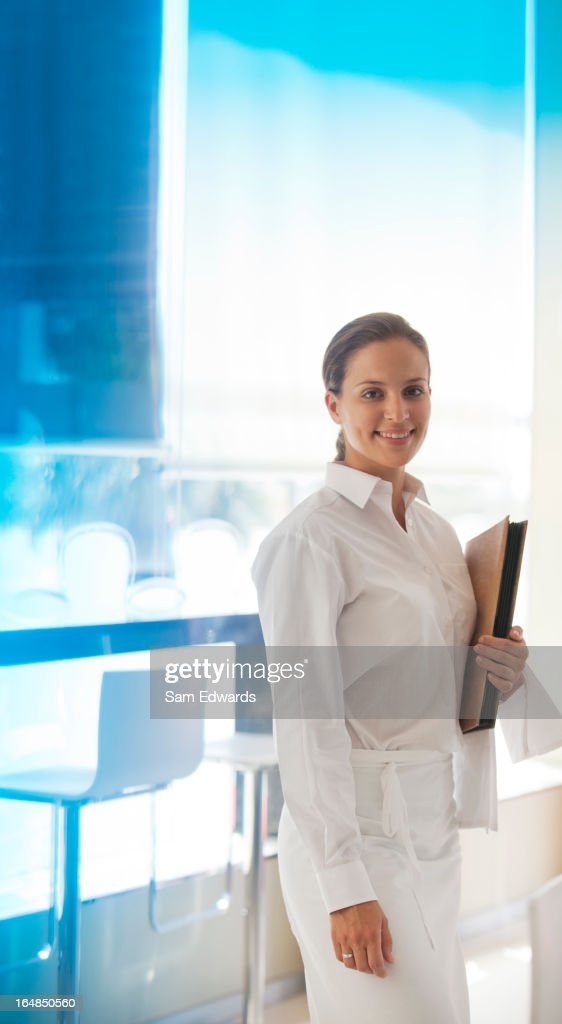 Waitress smiling in restaurant : Stock Photo