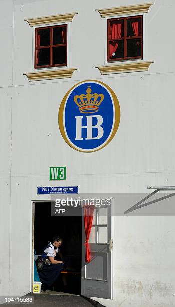 A waitress takes a break sitting in the door of a beer tent at the Theresienwiese in Munich October 4 2010 After more than two weeks the world's...