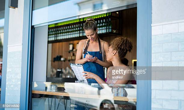 Waitress taking orders at a restaurant