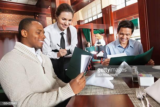 Waitress taking restaurant guest's order