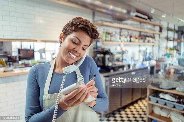 Waitress talking on the phone at a restaurant