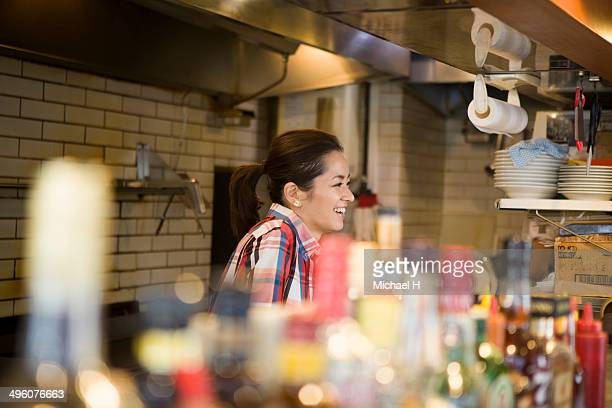 Waitress talking with customer in local restaurant