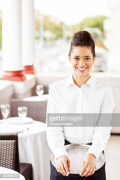 Waitress With Serving Tray Smiling In Restaurant