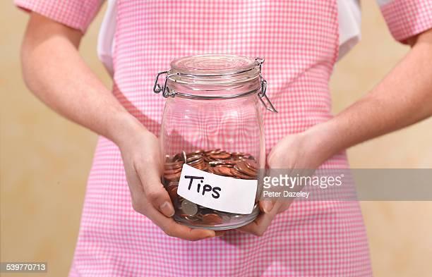 Waitress with tips jar